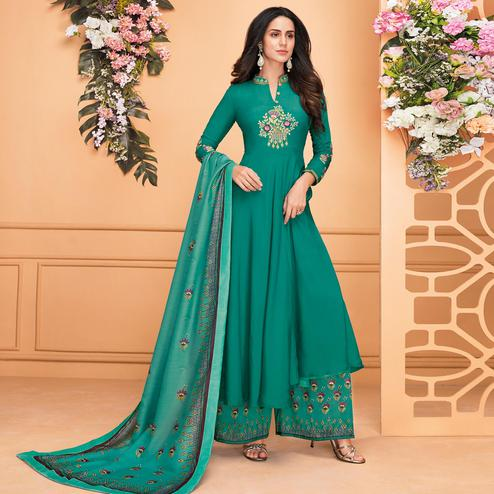 Delightful Turquoise Green Colored Partywear Embroidered Muslin Palazzo Suit