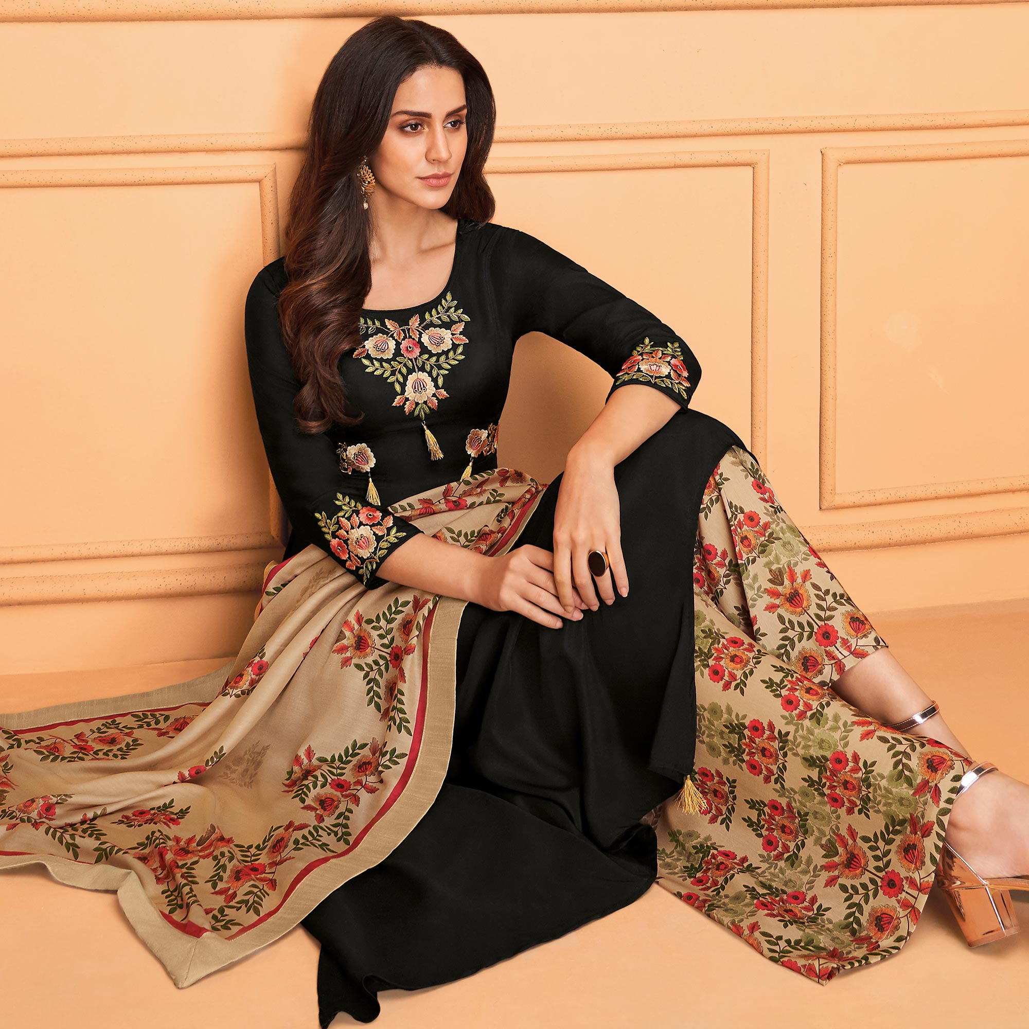 Engrossing Black Colored Partywear Embroidered Muslin Palazzo Suit