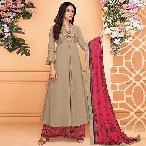 Captivating Beige Colored Partywear Embroidered Muslin Palazzo Suit