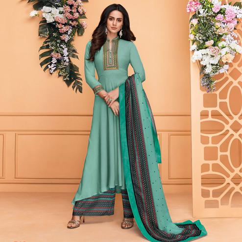 Fantastic Aqua Blue Colored Partywear Embroidered Muslin Palazzo Suit