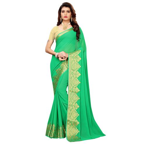 Impressive Green Colored Casual Woven Georgette Saree