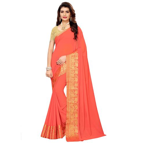 Desirable Peach Colored Casual Woven Georgette Saree