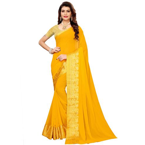 Exotic Yellow Colored Casual Woven Georgette Saree