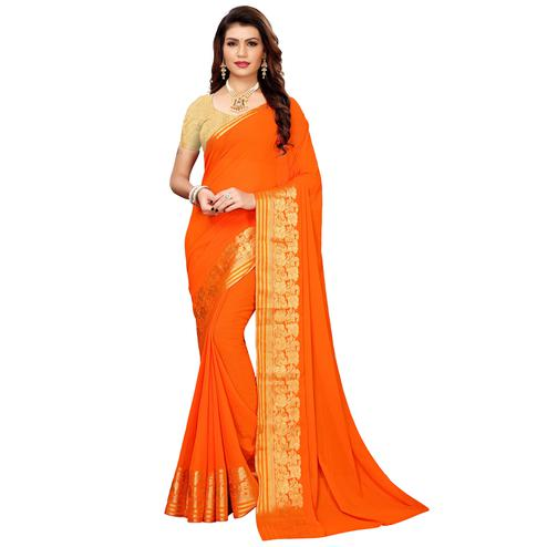 Sophisticated Orange Colored Casual Woven Georgette Saree