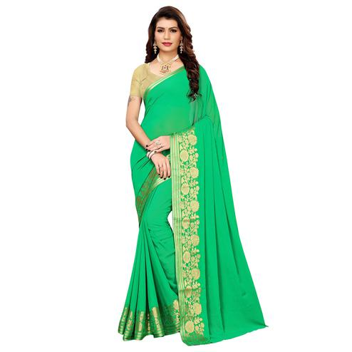 Alluring Green Colored Casual Woven Georgette Saree