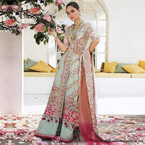 Stunning Pastel Green Colored Partywear Embroidered Netted Palazzo Suit