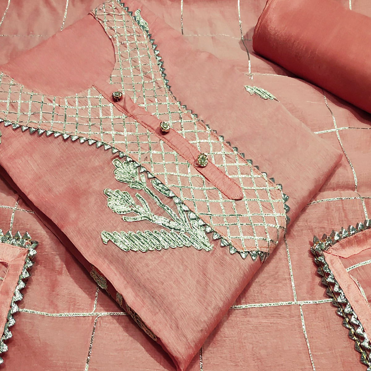 Opulent Peach Colored Partywear Embroidered Silk Dress Material
