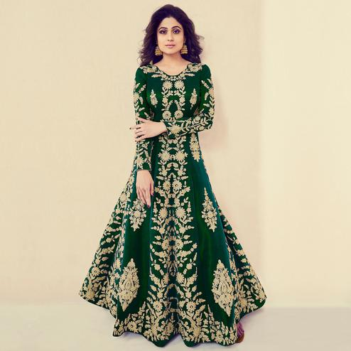 Charming Green Colored Partywear Embroidered Banarasi Silk Anarkali Suit