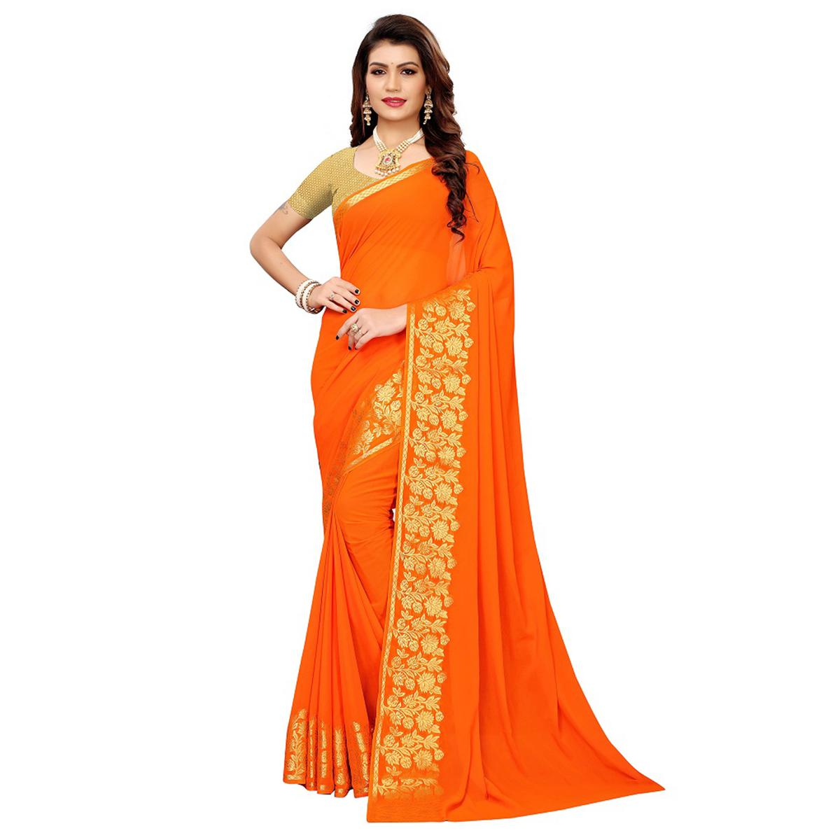 Graceful Orange Colored Casual Woven Georgette Saree