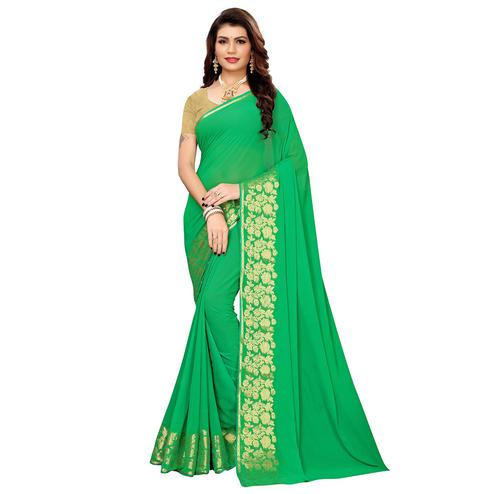 Delightful Green Colored Casual Woven Georgette Saree