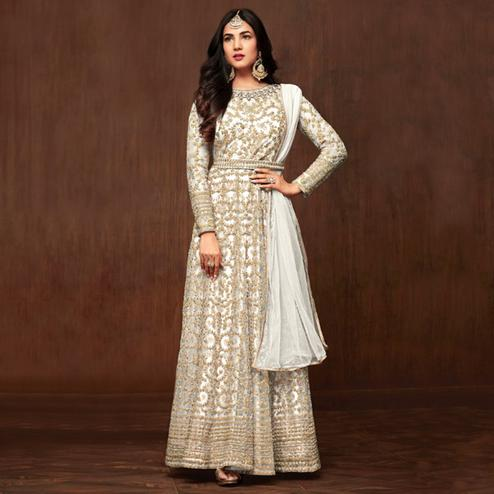 Lovely White Colored Partywear Embroidered Netted Anarkali Suit