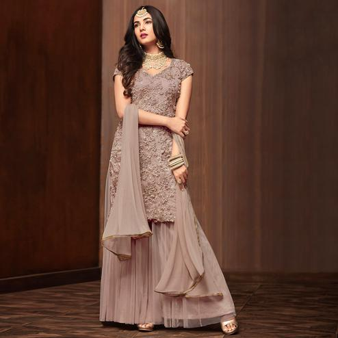 Mesmerising Mauve Colored Partywear Embroidered Netted Palazzo Suit