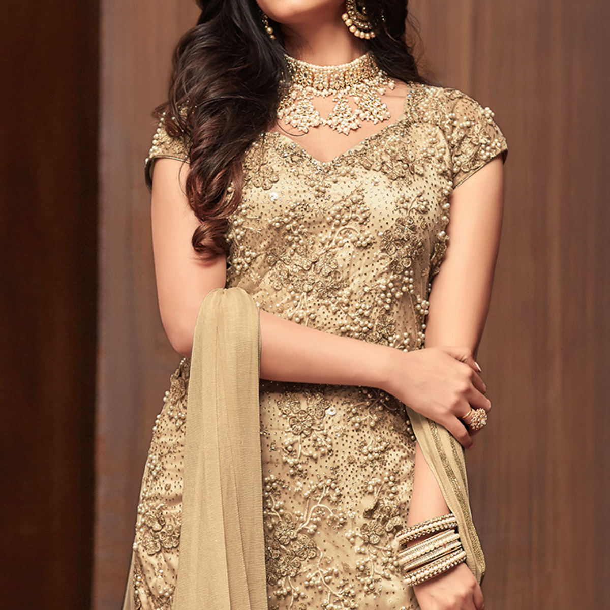 Breathtaking Beige Colored Partywear Embroidered Netted Palazzo Suit