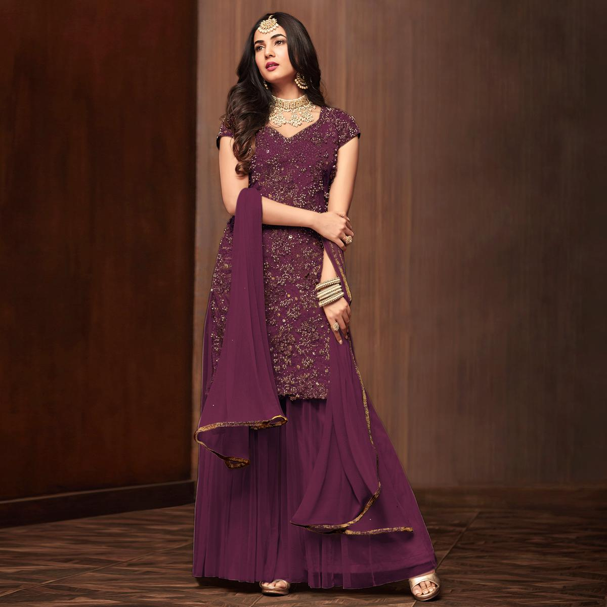 Staring Purple Colored Partywear Embroidered Netted Palazzo Suit
