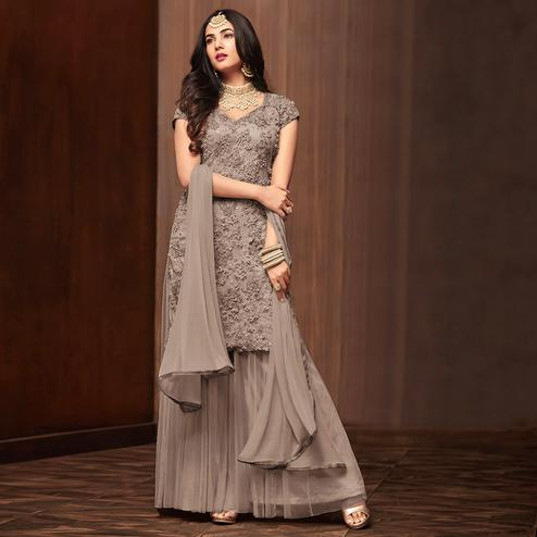 Dazzling Gray Colored Partywear Embroidered Netted Palazzo Suit