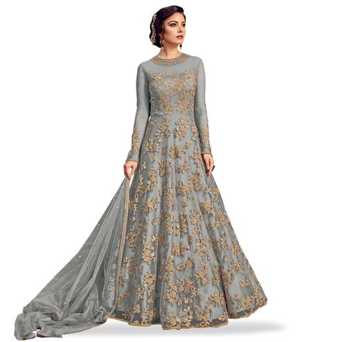 Exotic Gray Colored Partywear Embroidered Netted Anarkali Suit