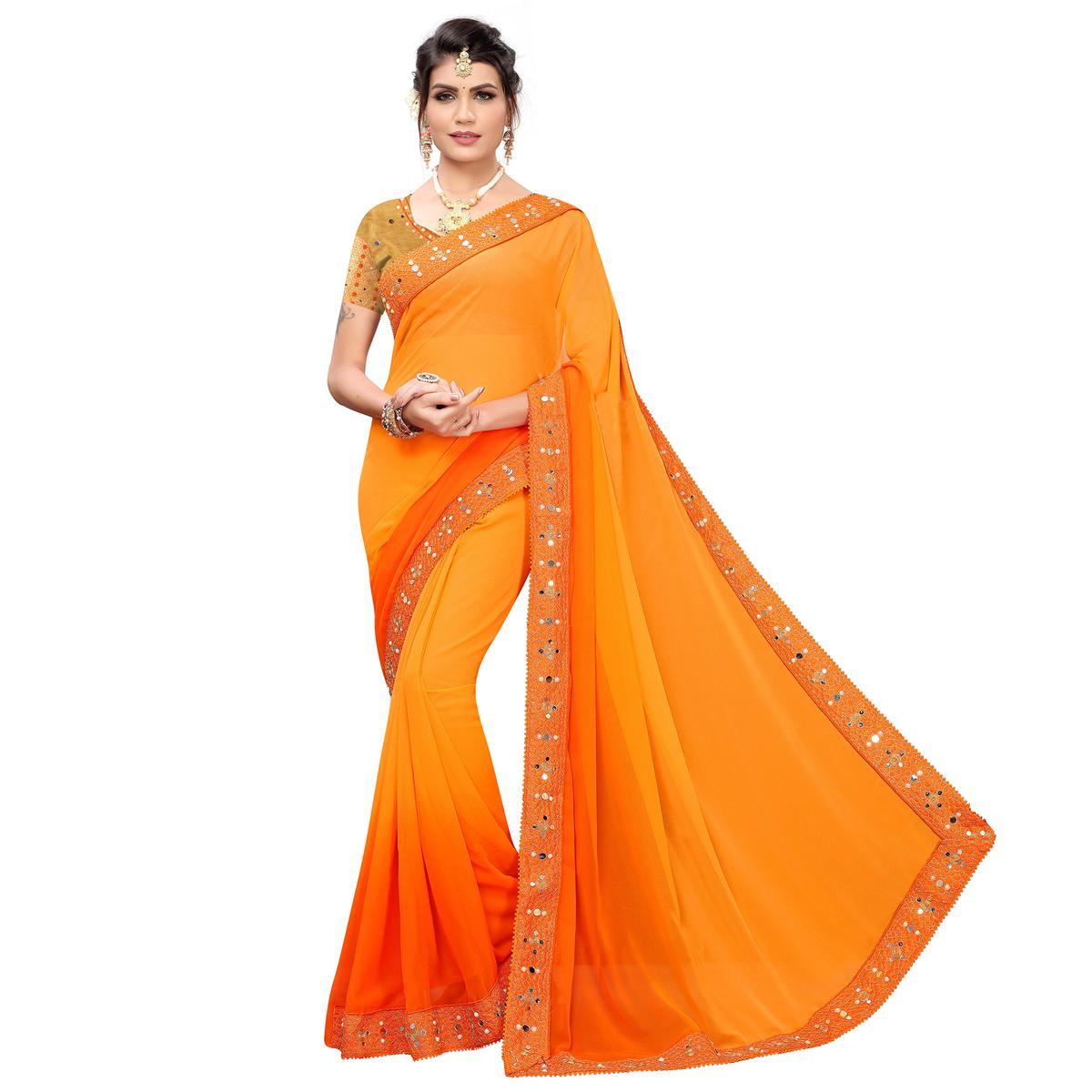Exceptional Orange Colored Partywear Embroidered Georgette Saree