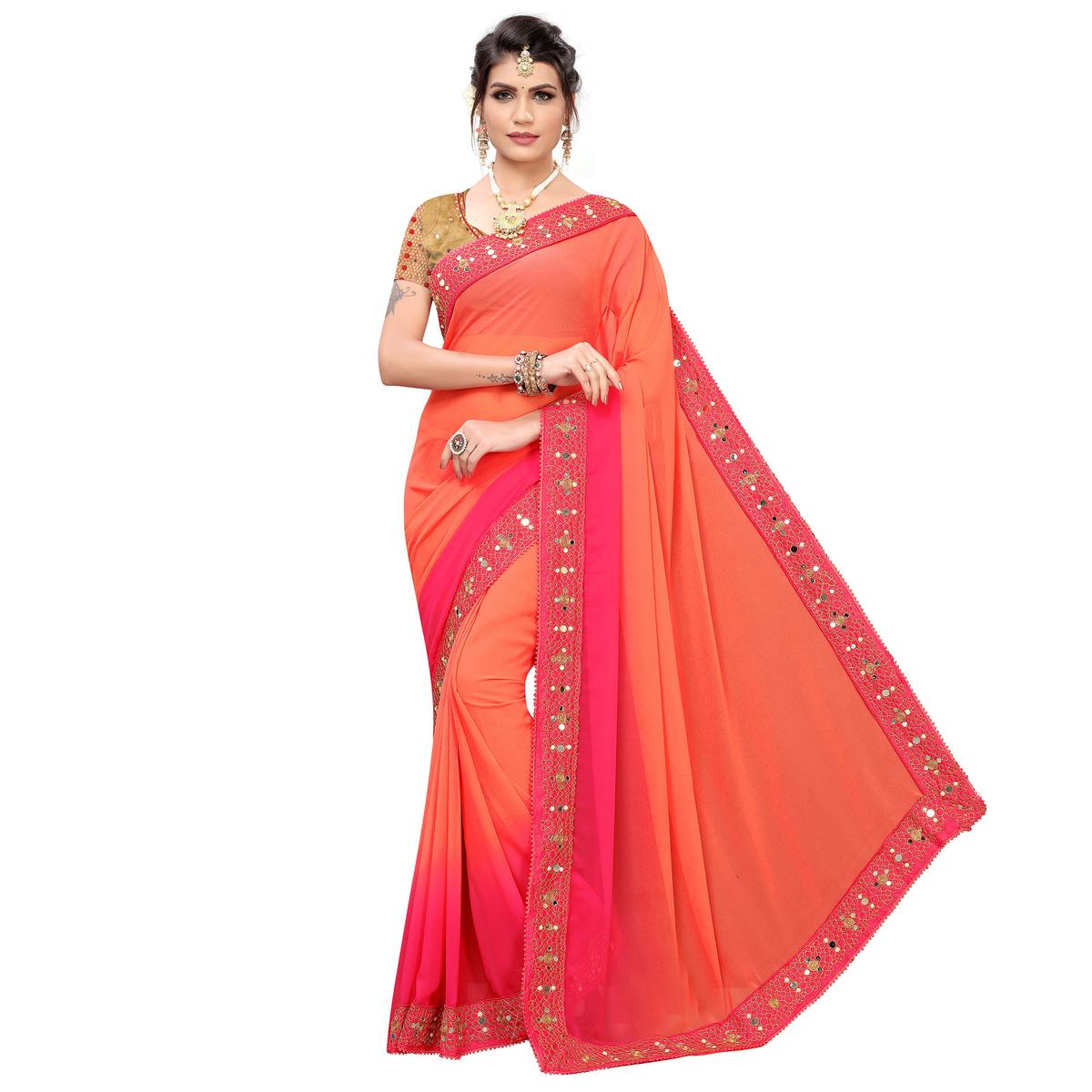 Gleaming Peach Colored Partywear Embroidered Georgette Saree