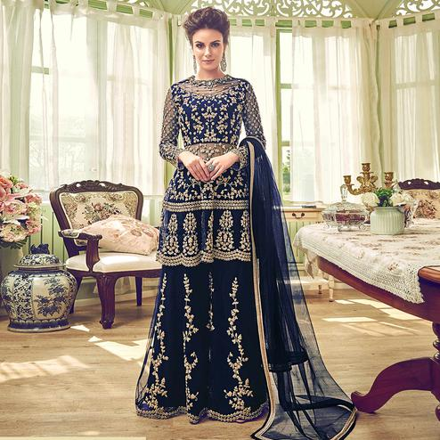 Capricious Blue Colored Partywear Embroidered Netted Palazzo Suit
