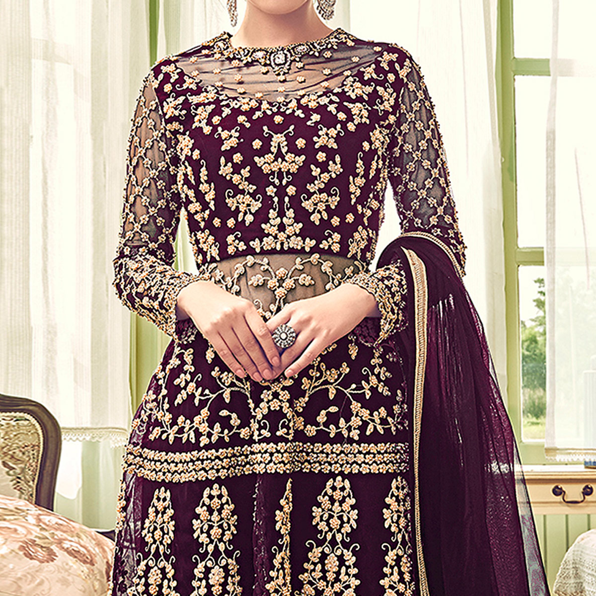 Entrancing Purple Colored Partywear Embroidered Netted Palazzo Suit