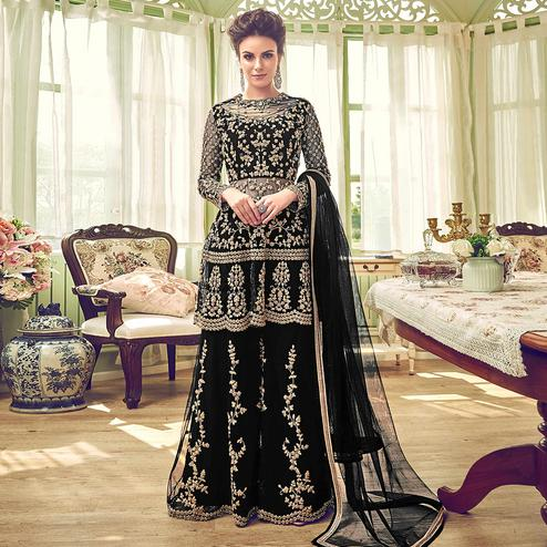 Prominent Black Colored Partywear Embroidered Netted Palazzo Suit