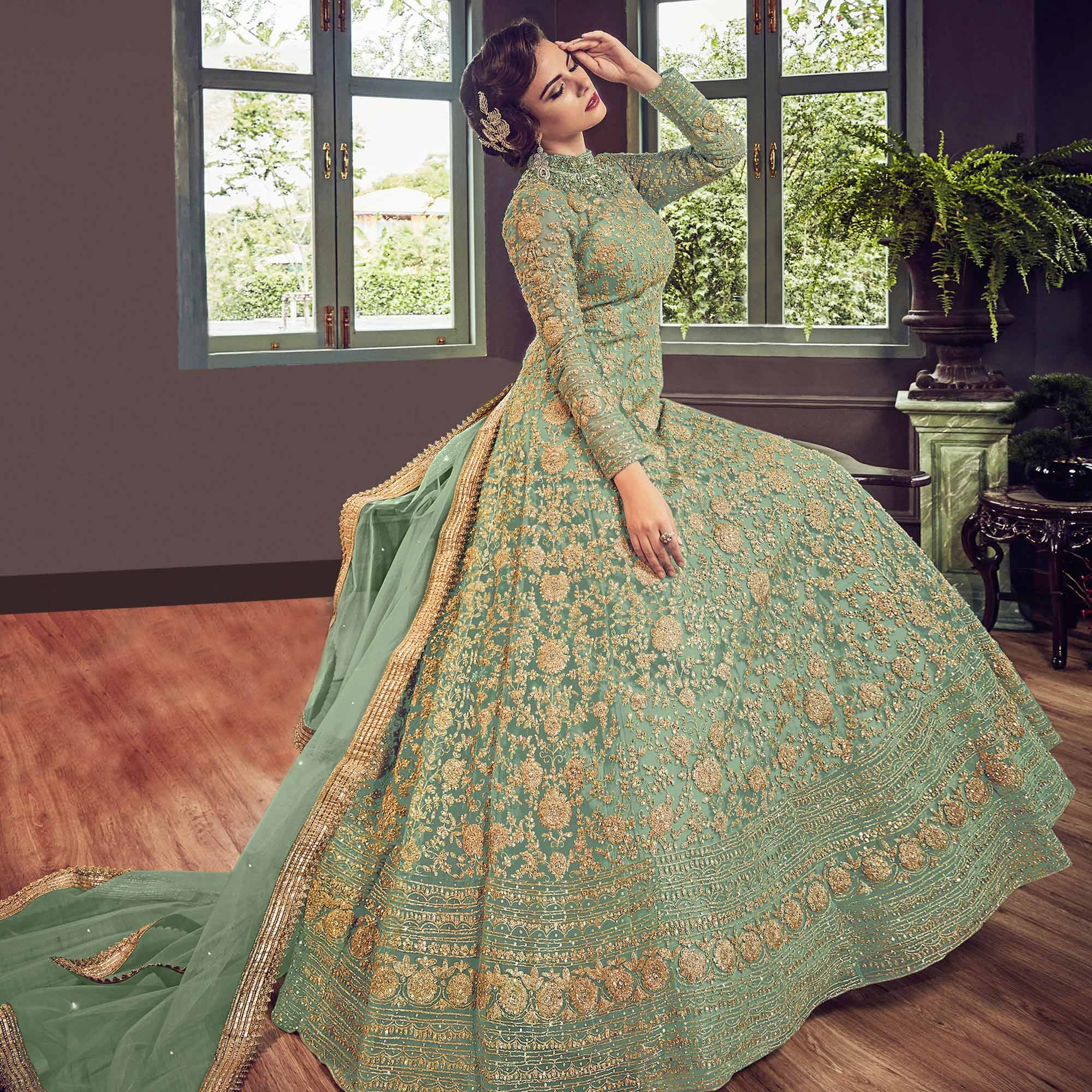 Glowing Mint Green Colored Partywear Embroidered Netted Anarkali Suit