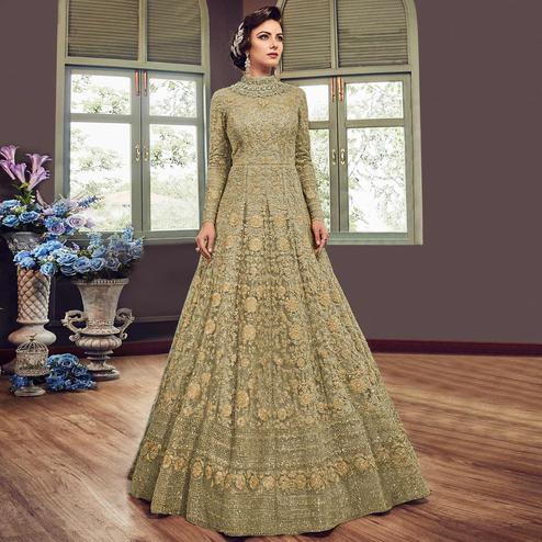 Exceptional Pastel Olive Green Colored Partywear Embroidered Netted Anarkali Suit