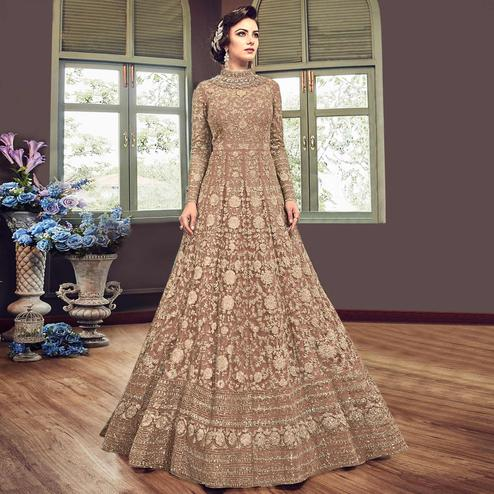 Unique Brown Colored Partywear Embroidered Netted Anarkali Suit