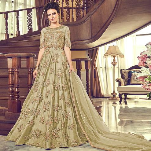 Magnetic Olive Green Colored Partywear Embroidered Netted Anarkali Suit