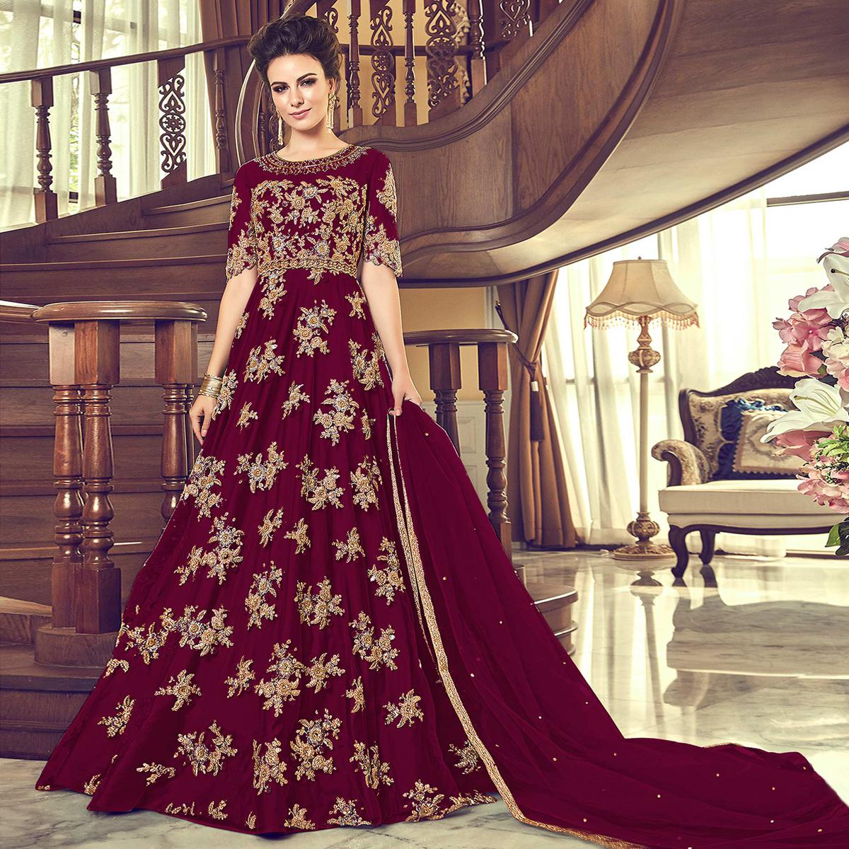 Hypnotic Dark Magenta Pink Colored Partywear Embroidered Netted Anarkali Suit