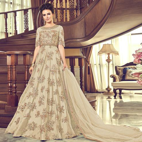 Excellent Cream Colored Partywear Embroidered Netted Anarkali Suit
