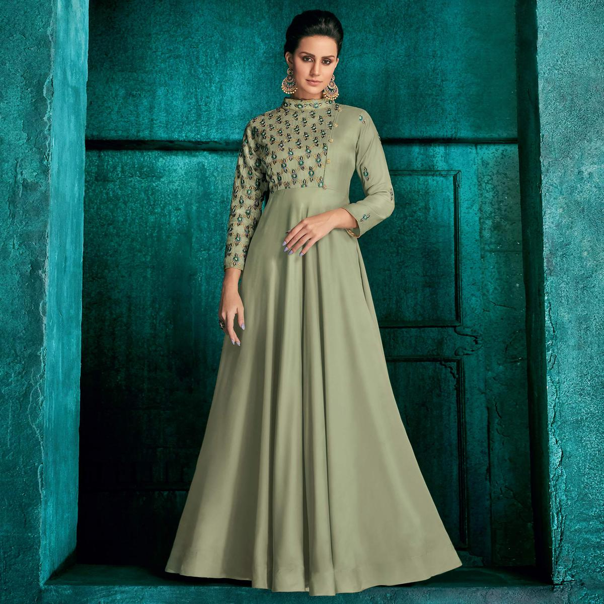 Pretty Pastel Green Colored Partywear Embroidered Silk Gown