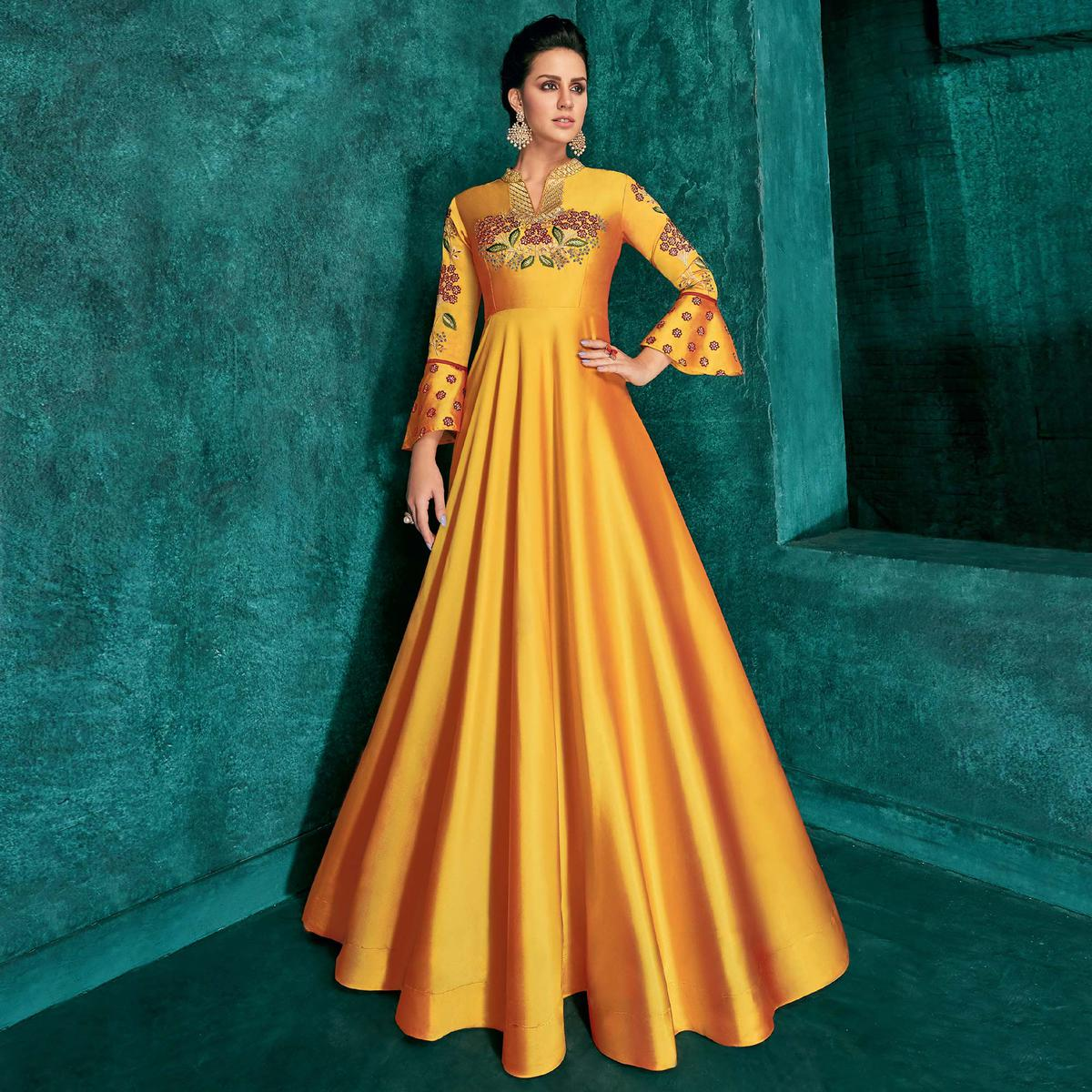 Staring Yellow Colored Partywear Embroidered Silk Gown