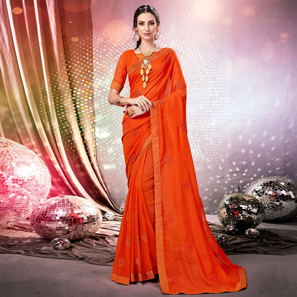 Lovely Orange Colored Parytwear Embroidered Georgette Saree