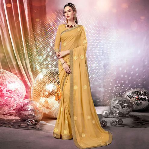 Impressive Beige Colored Parytwear Embroidered Georgette Saree