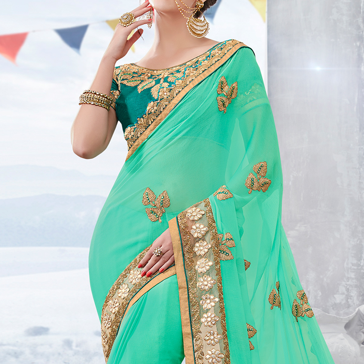 Jazzy Turquoise Green Colored Partywear Embroidered Georgette Saree