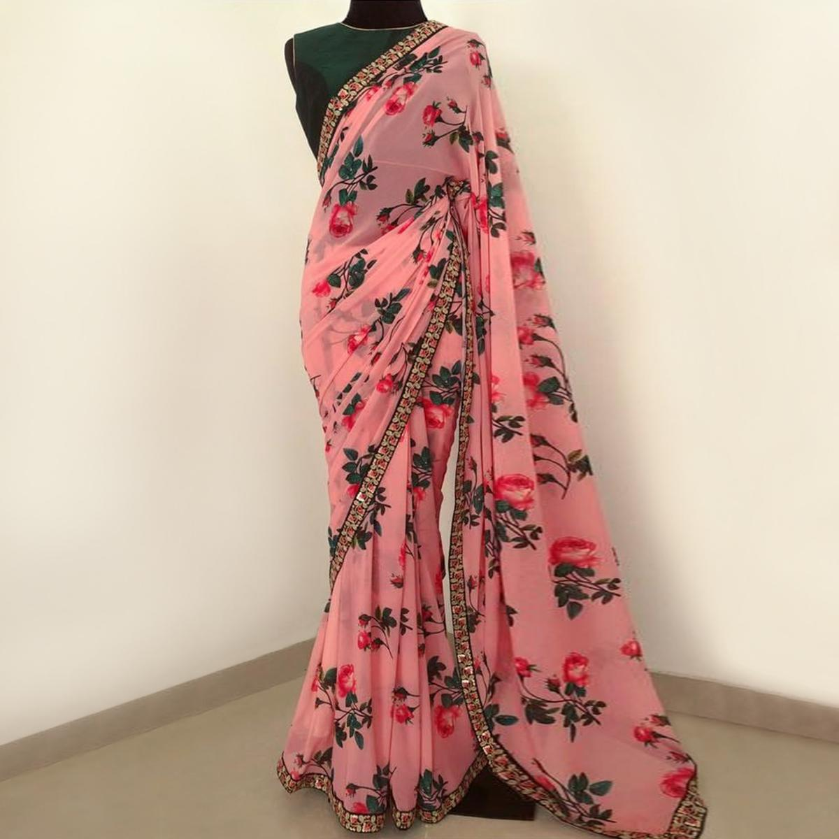 Intricate Pink Colored Partywear Floral Printed Georgette Saree