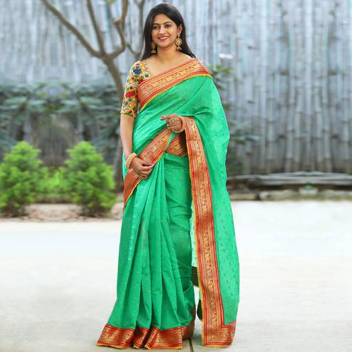 Capricious Green Colored Festive Wear Woven Cotton Silk Saree