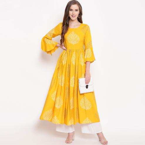 Appealing Yellow Colored Partywear Printed Rayon Kurti