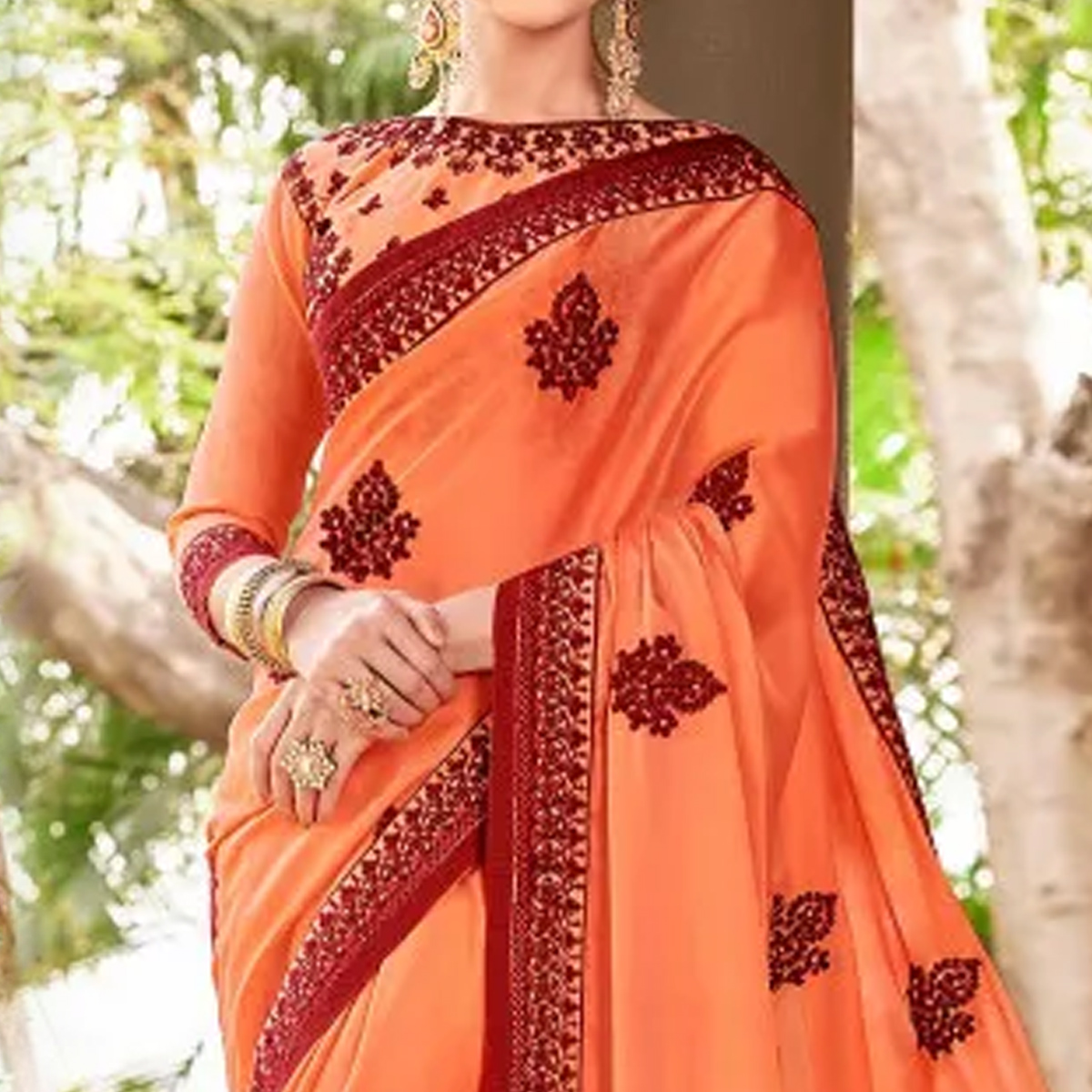 Attractive Orange Colored Partywear Embroidered Georgette Saree