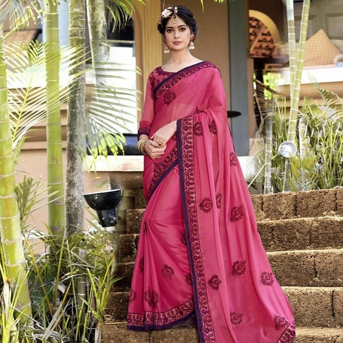 Graceful Pink Colored Partywear Embroidered Georgette Saree