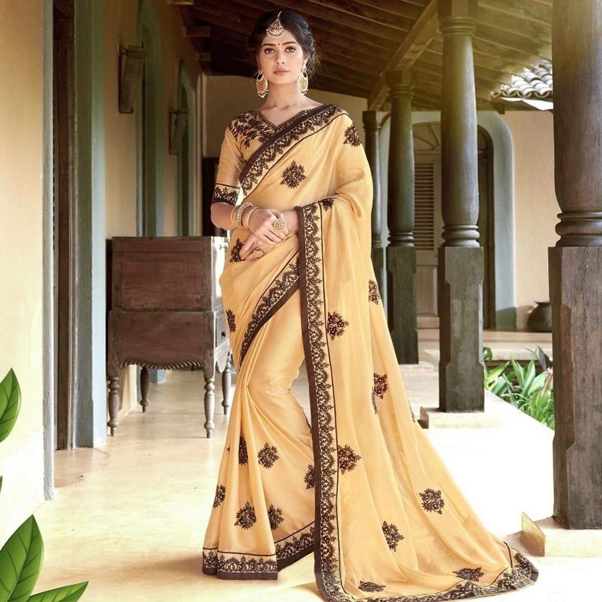 Blooming Cream Colored Partywear Embroidered Georgette Saree
