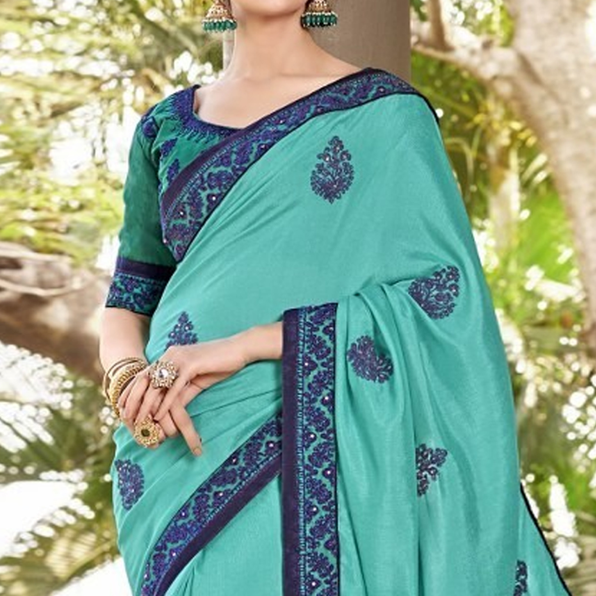 Charming Turquoise Green Colored Partywear Embroidered Georgette Saree