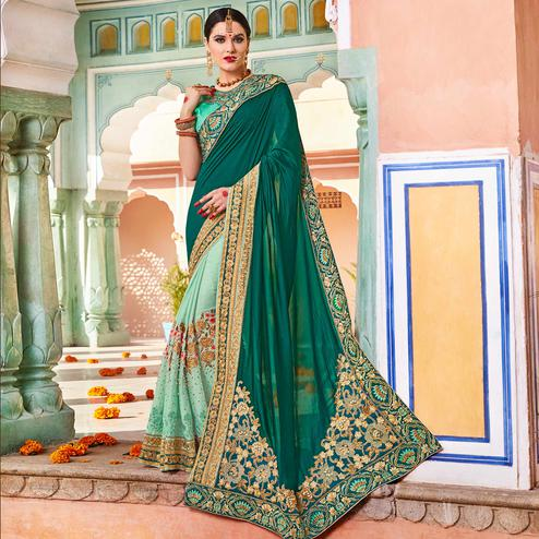 Demanding Teal Green Colored Partywear Embroidered Heavy Georgette Half-Half Saree