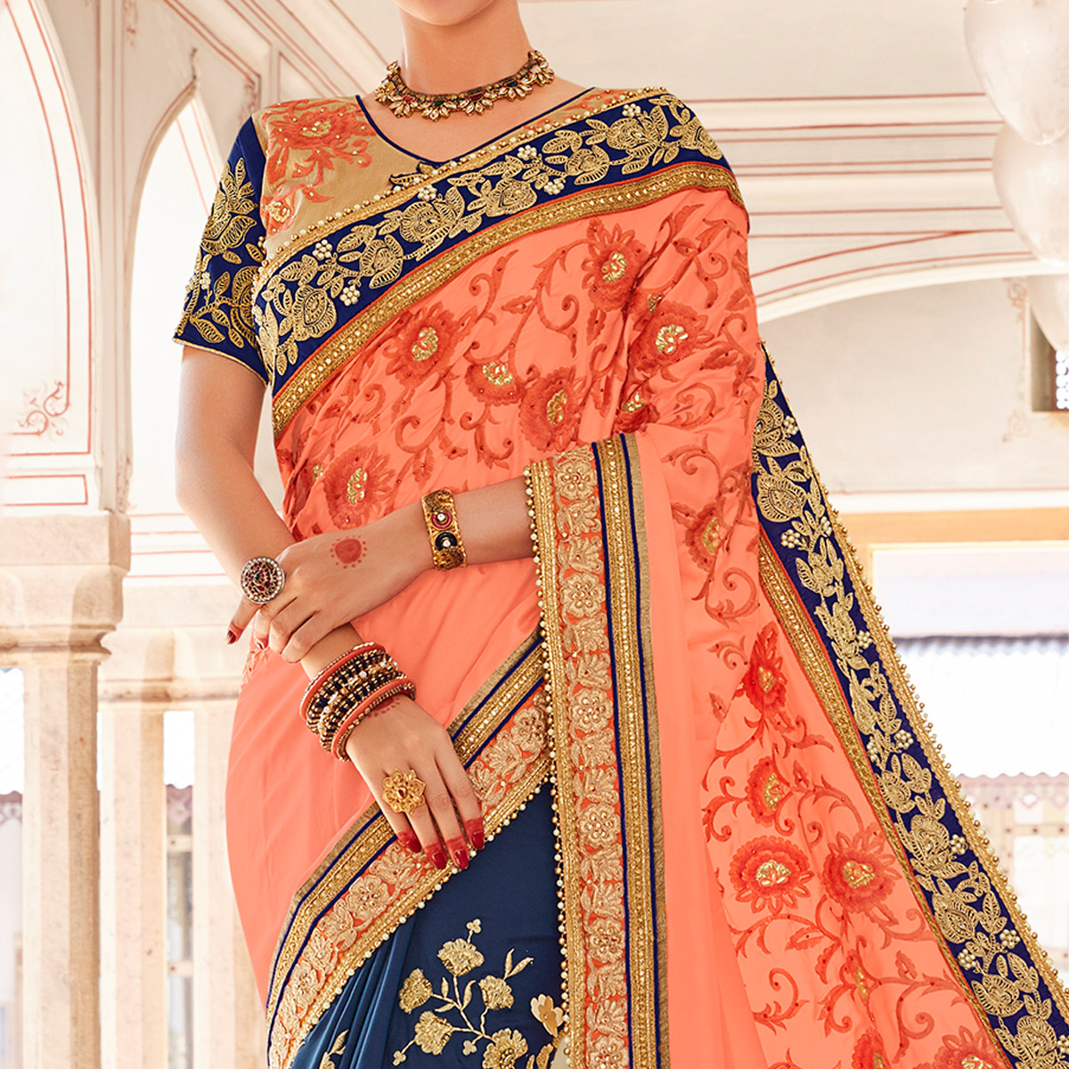 Magnetic Peach-Navy Blue Colored Partywear Embroidered Heavy Georgette Half-Half Saree