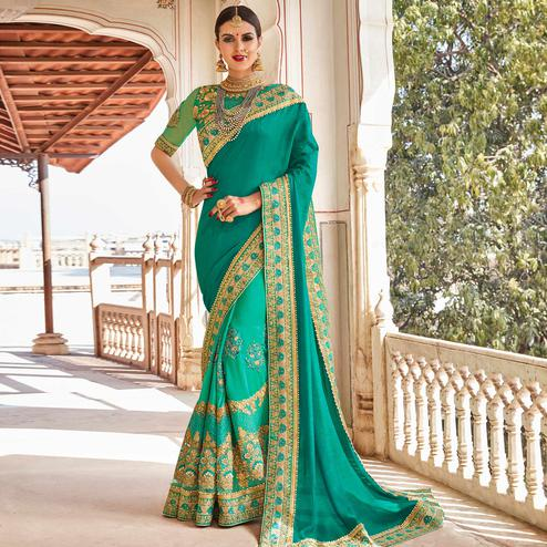 Excellent Turquoise Green Colored Partywear Embroidered Heavy Georgette Half-Half Saree