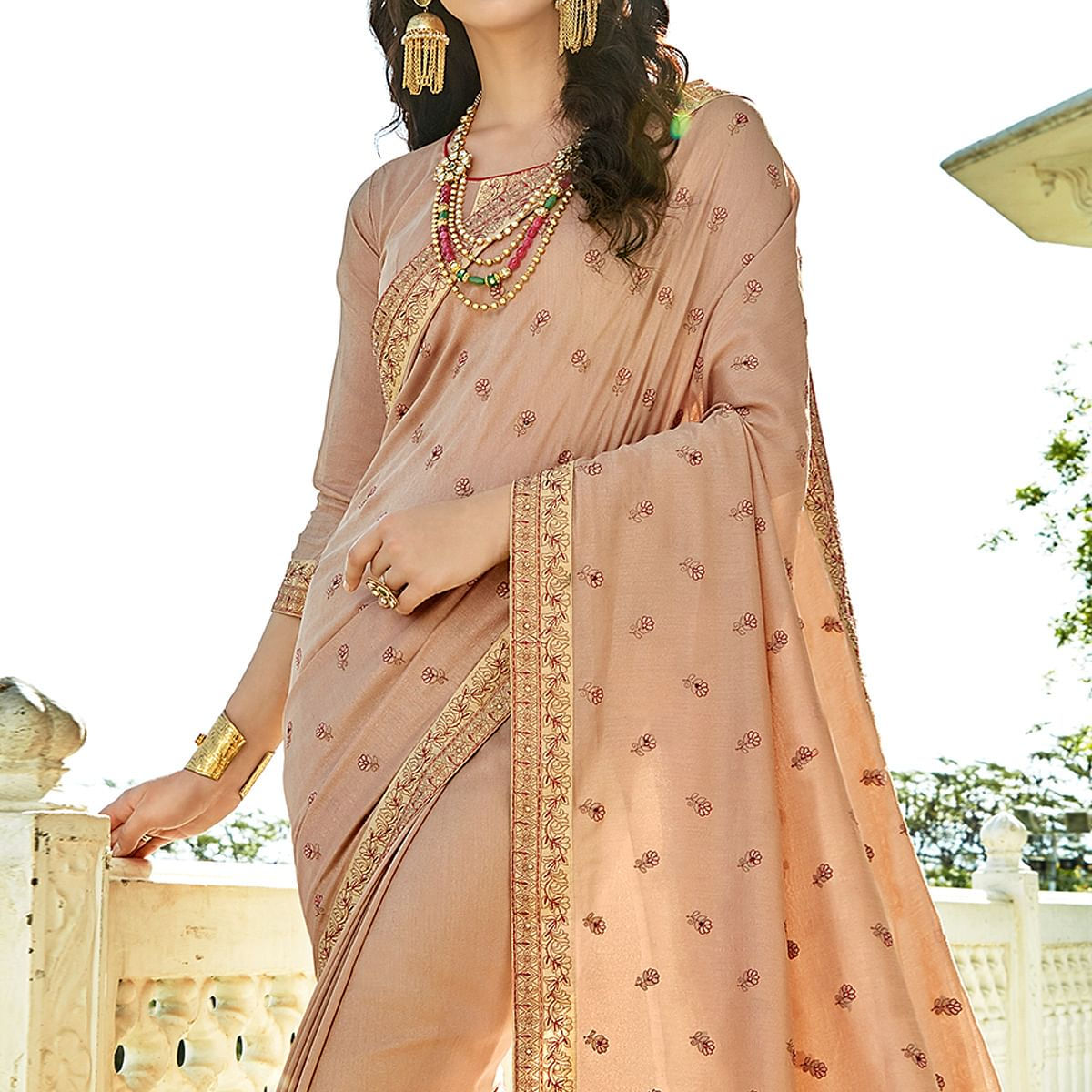 Lovely Beige Colored Party Wear Embroidered Georgette Saree