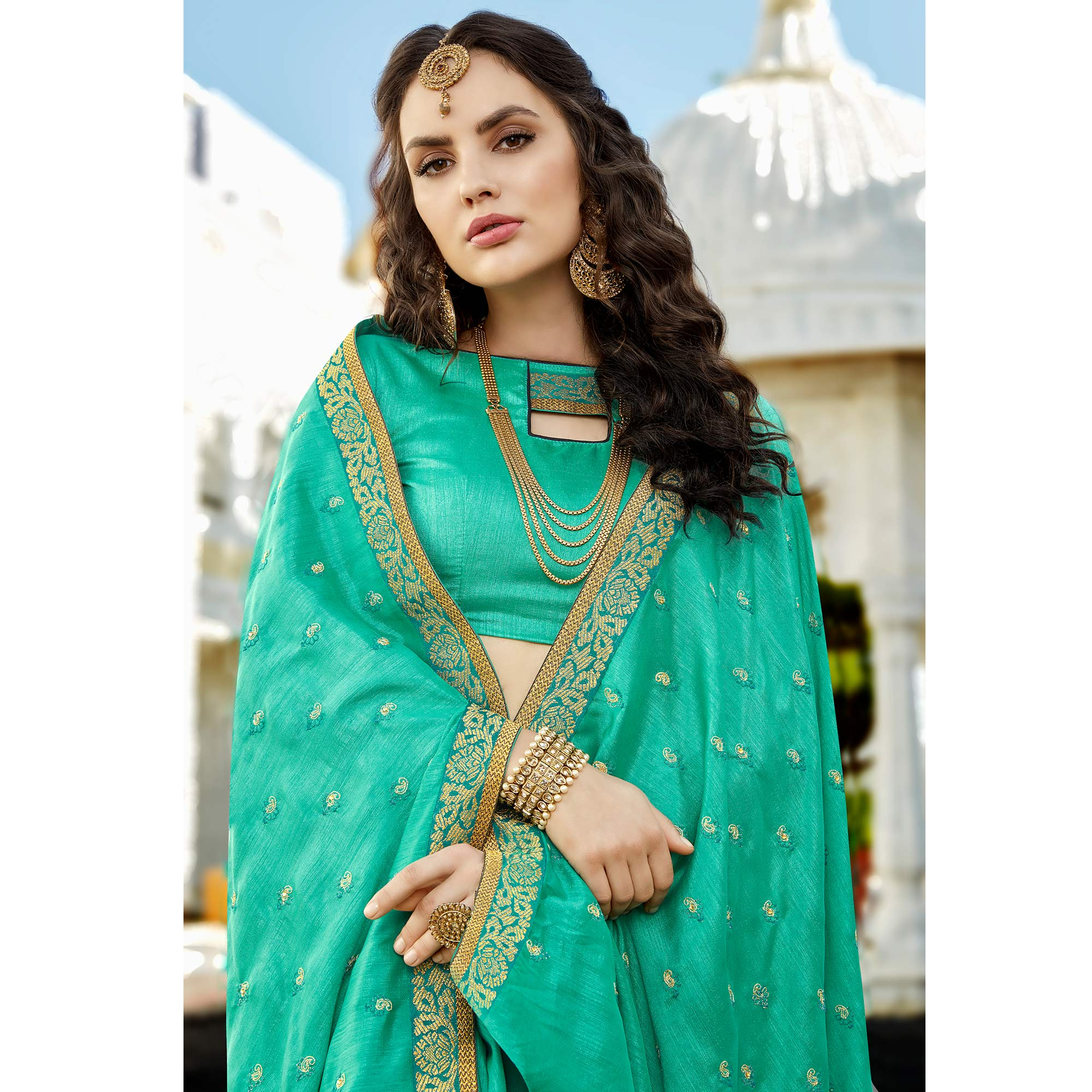 Charming Turquoise Green Colored Party Wear Embroidered Georgette Saree