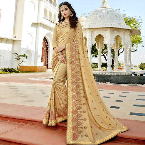 Gorgeous Cream Colored Party Wear Embroidered Georgette Saree