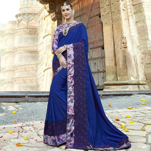 Lovely Blue Colored Partywear Embroidered Georgette Saree
